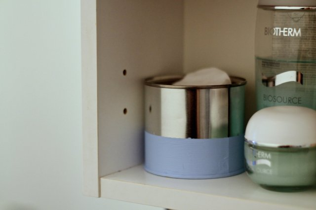 upcycled tin can bathroom storage